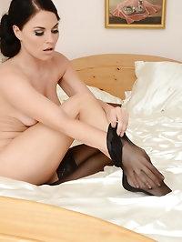 Brunette babe Miss Harris in bedroom pictures