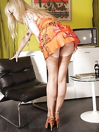 Sexy Lady in Orange dress and stockings