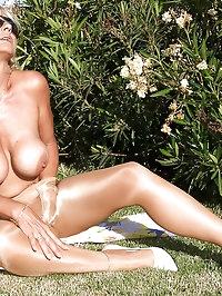 Leggy MILF Astrid in shiny Wolford pantyhose