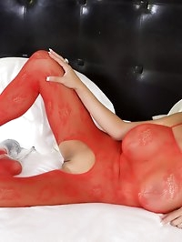 Sexy busty blonde, Rachel Aziani, poses in her red lace..