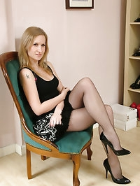 Cute blonde Iona is at home getting turned on by trying on..