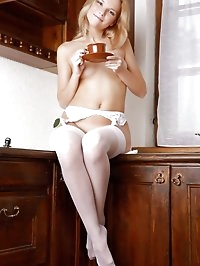 Beautiful blonde wearing nothing but white stockings and a..
