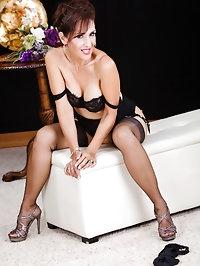 Beautiful big tit mature model looks great