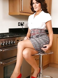 Gorgeous brunette poses as a secretary and strips down to..