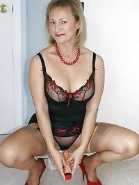 Alluring woman has a hard dildo