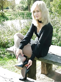 Beautiful Laura is outside and showing off her nylon..