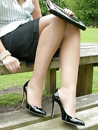 Hot blonde Milf Jess shows her shiny black heels and..
