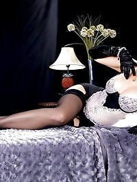 Black stockings are making this stunning babe look special