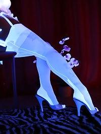 Model Nadja wearing white lingerie during blacklight session