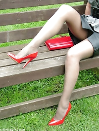 Nylon stockings and red high heels cover this sexy blondes..