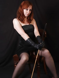 Sexy red head wearing some saucy leather gloves