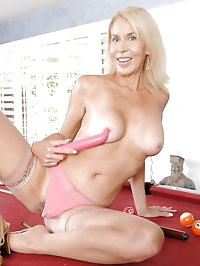Seductive blonde milf gently strokes her Anilos pussy with..