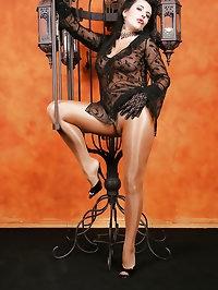 Seductive slut wears all black with nude hose