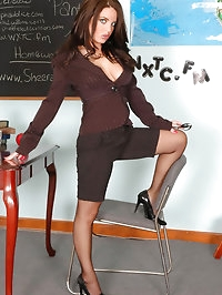 Brunette in nylons with sexy legs