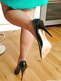 A very sexy blonde wearing black high heel shoes