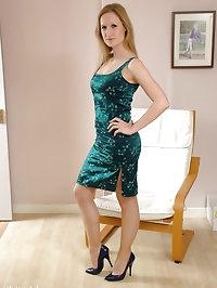 Naughty looking blonde wearing blue high heels