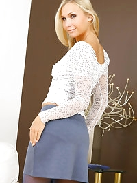 Stunning blonde in cute top blue skirt and blue pantyhose.