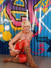 Gorgeous MILF Sally T in red panties and see through top..