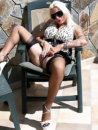 Huge boobed Ginette vibes her pierced pussy