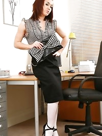 Model Kayleigh looks extremely sexy in her office posing..