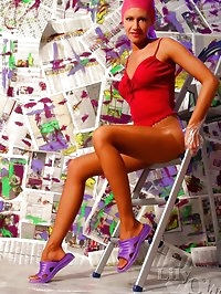 Leggy beauty LilyWOW posing in tan pantyhose
