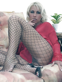 Horny Lana gives her guy a great footjob in fishnet..