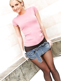 Tammy in denim miniskirt and pink tight top.