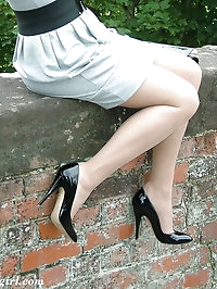 Black high heels and see-through nylons cover this sexy..
