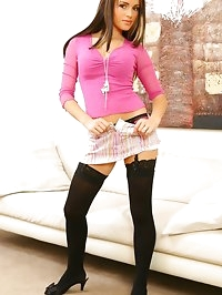 Breathtaking brunette wearing miniskirt and cropped pink..