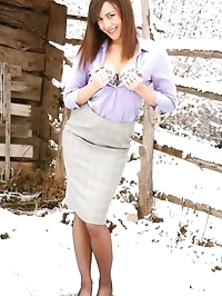 Emma H looking stunning in the snow in her sexy secretary..