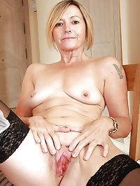 Hot 49 year old Susie slips off her working clothes to..