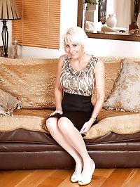 Hot blonde milf Jan Burton strokes her slippery pink..