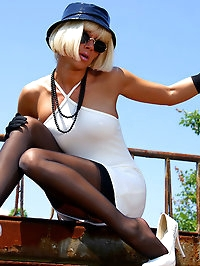Sexy blonde MILF LilyWOW in black stockings outdoor
