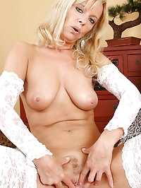 Blonde and mature Merilyn unwraps herself just for you in..