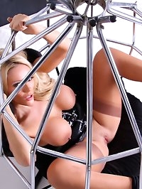 Naughty blonde Lucy Zara is bound by her ankles and forced..