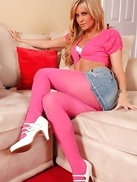 Samantha K in a denim miniskirt, tight pink cropped top..