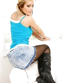 Natasha in denim miniskirt and hides her legs under black..