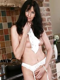 Long haired brunette MILF Scarlett D shows off her mature..