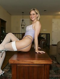Hot blonde milf wife in Purple Bustier and White Stockings
