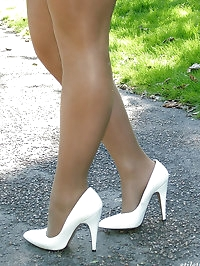 Gorgeous blonde posing outdoors in her sexy high heels