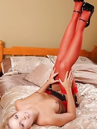 Jenni P in bright red stockings and patent high heels.