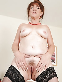 Elegant looking redhead Gypsy Lee pulling at her trimmed..