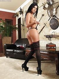 Lady wears black stockings during masturbation
