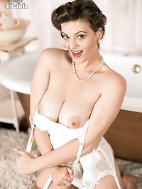 Join Lottii at her bath, getting her sexy nylons extra..