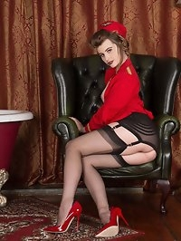 Brook is one sexy air hostess in her clingy red uniform..