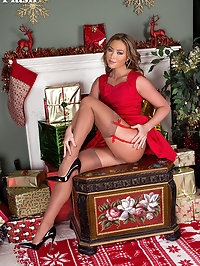 Stocking clad Natalia gets turned on by her designer heels..