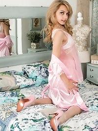Chloe on the bed in skimpy nylon baby doll, 60s pop art..