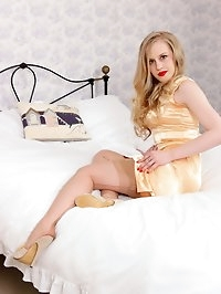 In shimmering gold satin, racy blonde Lucy enters the..