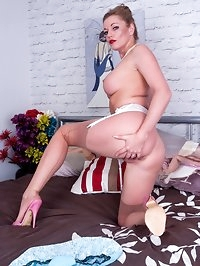 Holly comes away for a sexy stay in a motel room, wearing..