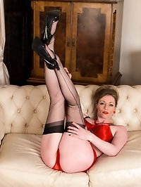 Check out Holly in her red sexy lingerie and black vintage..